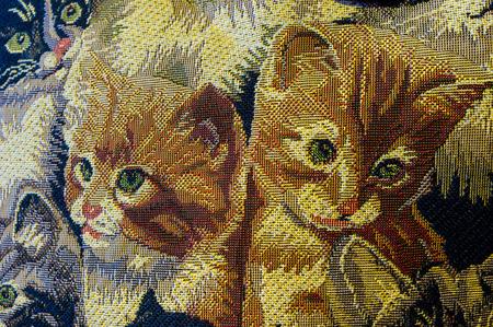 Two little red kittens on the gobelin. Reklamní fotografie