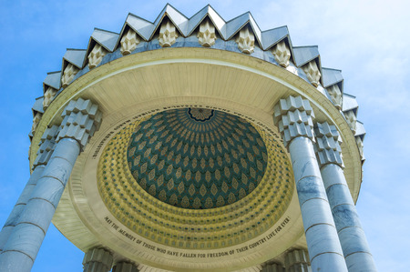repression: TASHKENT, UZBEKISTAN - MAY 7, 2015: The cupola of the memorial to the victims of repression decorated with islamic patterns and carved stone pillars, on May 5 in Tashkent. Editorial