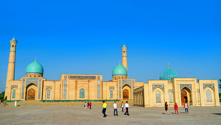 TASHKENT, UZBEKISTAN - MAY 7, 2015: The small Muyi Muborak Madrasah with the huge Hazrat Imam Mosque on the background,  on May 5 in Tashkent.