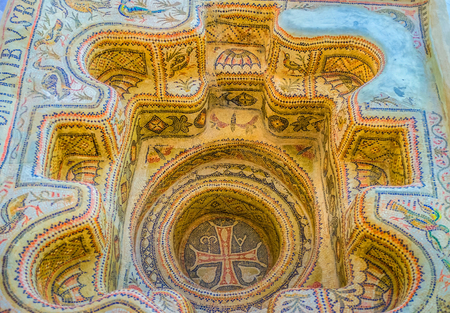 baptizing: SOUSSE, TUNISIA - SEPTEMBER 1, 2015: The ancient mosaic baptistery decorated with colorful animalistic traceries, on September 1 in Sousse.