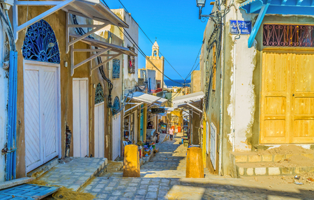 SOUSSE, TUNISIA - SEPTEMBER 1, 2015: One of the central streets of Medina that leads to the port is the old market, on September 1 in Sousse. Publikacyjne