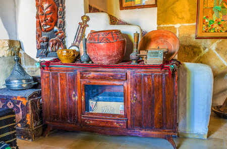 old furniture: SOUSSE, TUNISIA - SEPTEMBER 1, 2015: The old restaurants and mansions in Medina are often decorated in retro style with old furniture and different objects, on September 1 in Sousse.