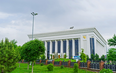 forums: TASHKENT, UZBEKISTAN - MAY 7, 2015: The view on the Palace of International Forums from the lush garden on Amir Timur Square, on May 7 in Tashkent. Editorial