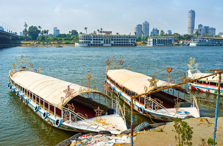 nile river: CAIRO, EGYPT - OCTOBER 10, 2014: The embankment of the Nile river with the moored pleasure boats and the skyskapers of Gesira Island on the background, on October 10 in Cairo. Editorial