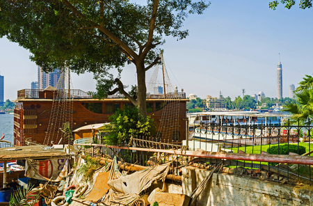 nile river: CAIRO, EGYPT - OCTOBER 10, 2014: The different restaurants on Nile river offer the local cuisine and scenic views on Gesira Island, on October 10 in Cairo.