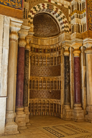 in ceiling: CAIRO, EGYPT - OCTOBER 12, 2014: The mihrab, decorated with islamic patterns of carved stone in Qalawun Mausoleum in the same named complex, on October 12 in Cairo.