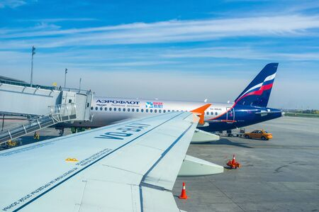 departing: Kiev, Ukraine - April 24, 2015: The silver aircraft of Aeroflot airlines is preparing for departing from Boryspil airport, on April 24 in Kiev. Editorial