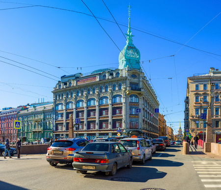 xx century: Saint Petersburg - April 24, 2015: The Trade House Esdersa and Sheyfals with a high spire is a good example of the russian architecture of the begining of XX century, on April 24 in Saint Petersburg. Editorial