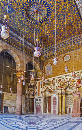 ceiling tile: CAIRO, EGYPT - OCTOBER 10, 2014: The prayer hall of the mosque Al-Nasir Muhammad funerary complex decorated with colorful stone patterns and gilt islamic ornaments on ceiling, on October 10 in Cairo. Editorial