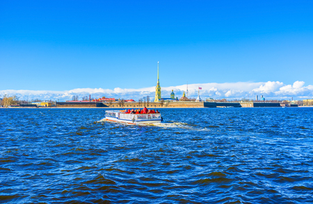 very cold: Northern winds over Neva River are very cold, but tourists make boat trips anyway, Saint Petersburg, Russia. Stock Photo