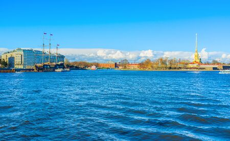 warship: The view on the Neva embankment with moored replica medieval warship and the Peter and Paul Cathedral on the Zayachy Island, Saint Petersburg, Russia. Stock Photo