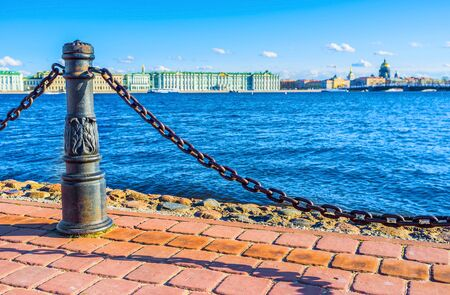 embankment: The cast-iron chain berrier on the embankment of the Zayachy Island in Saint Petersburg.