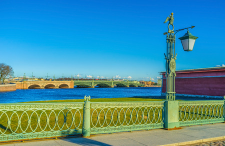 peterburg: The beautiful green forged railings with double-bitted axes of the Ioanovsky Bridge, the first bridge of Saint Peterburg. Stock Photo