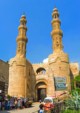 souq: CAIRO, EGYPT - OCTOBER 12, 2014: The medieval Gates of Bab Zuweila located in heart of Islamic Cairo and surrounded by noisy arabic souq (market), on October 12 in Cairo.