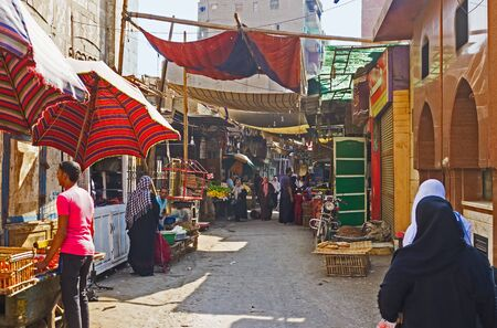 souq: CAIRO, EGYPT - OCTOBER 12, 2014: The dusty souq on Al Motaz street among the old slums in the poor neighborhood, on October 12 in Cairo.