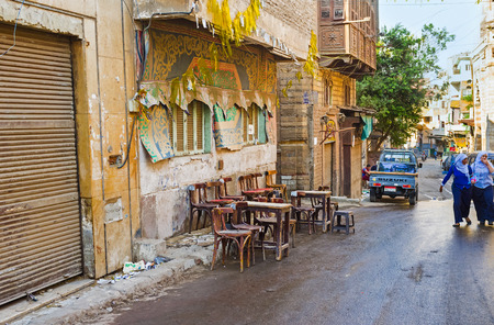 bab: CAIRO, EGYPT - OCTOBER 12, 2014: The old street teahose in Bab Al Khalq district, the owner splashed water on the road to keep down the dust, on October 12 in Cairo.