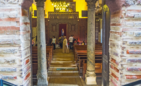 iconostasis: CAIRO, EGYPT - OCTOBER 12, 2014: The view on the prayer hall of Abu Sarga church from its entrance with two old columns, on October 12 in Cairo.