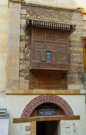 coptic orthodox: CAIRO, EGYPT - OCTOBER 12, 2014: The old carved wooden balcony over the entrance to the Chaplet of St George, on October 12 in Cairo.