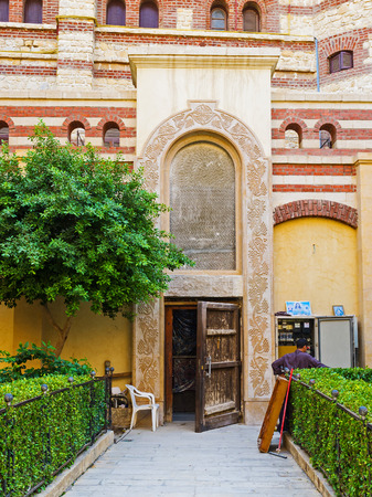 coptic orthodox: CAIRO, EGYPT - OCTOBER 12, 2014: The old side entrance to the Chaplet of St George, on October 12 in Cairo.