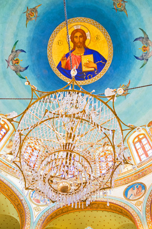 coptic orthodox: CAIRO, EGYPT - OCTOBER 12, 2014: The cupola of Mar Jirjis (St George) church with the painted icon of Jesus Christ, surrounded by seraphims, on October 12 in Cairo. Editorial
