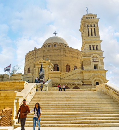 coptic orthodox: CAIRO, EGYPT - OCTOBER 12, 2014: The rotunda building of St George (Mar Jirjis) church with high belfry located in the Coptic quarter, on October 12 in Cairo.