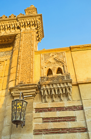 coptic orthodox: CAIRO, EGYPT - OCTOBER 12, 2014: The carved Gates to the Hanging church, decorated with arabic patterns and beautiful lantern, covered with metallic lace, on October 12 in Cairo. Editorial
