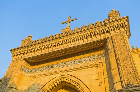 coptic orthodox: CAIRO, EGYPT - OCTOBER 12, 2014: The scenic carved Gates to the Hanging church, decorated with arabic patterns, on October 12 in Cairo. Editorial