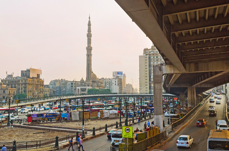 spontaneous: CAIRO, EGYPT - OCTOBER 10, 2014: The Ramses Square is the busiest place in Cairo, here locates railway station, bus terminus, spontaneous market and constant traffic jams on the overpass, on October 10 in Cairo.