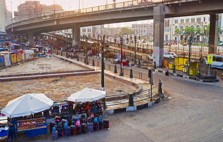 goods train: CAIRO, EGYPT - OCTOBER 10, 2014: The spontaneous market on th Ramses Square offers the wide range of goods for travelers, going to train on the local railway station, on October 10 in Cairo.