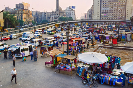 complication: CAIRO, EGYPT - OCTOBER 10, 2014: The Ramses Square is famous as one of the most chaotic places in city - spontaneous market on the transport road leads to the complication of traffic, on October 10 in Cairo.
