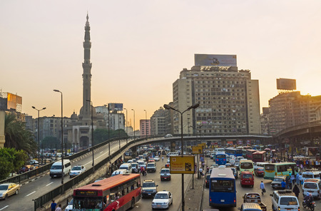 traffic jams: CAIRO, EGYPT - OCTOBER 10, 2014: The noisy evenning on the Ramses Square, the constant traffic jams on the local overpass next to the railway station, on October 10 in Cairo. Editorial