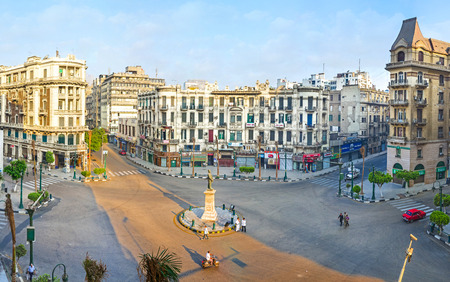 october: CAIRO, EGYPT - OCTOBER 10, 2014: The morning Talaat Harb square is empty and quiet - all the stores are closed and there are no cars and traffic jams, on October 10 in Cairo.