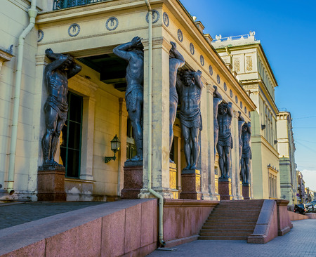 atlantes: SAINT PETERSBURG - APRIL 24, 2015: The  Portico of New Hermitage with atlantes are the most recognizable element of the facade of the museum, on April 24 in Saint Petersburg. Editorial