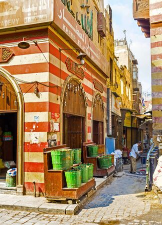 souq: CAIRO, EGYPT - OCTOBER 10, 2014: The corner of the old spices store, famous among tourists and gourmets, located in Khan el-Khalili souq, on October 10 in Cairo.