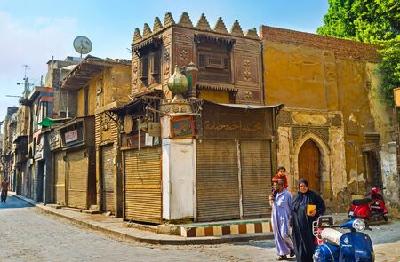 souq: CAIRO, EGYPT - OCTOBER 10, 2014: The stalls of Khan el-Khalili souq are old and dusty, but sometimes decorated with small cupolas and carvings, like arabic palaces or trading domes, on October 10 in Cairo. Editorial