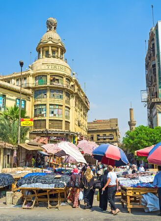 mini umbrella: CAIRO, EGYPT - OCTOBER 10, 2014: The former Tiring Department Store surrounded by the noisy Ataba market, on October 10 in Cairo.