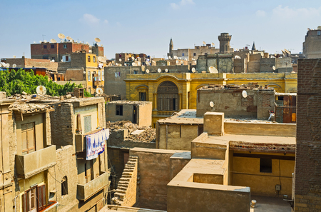 minarets: The terrace of the Palace of Amir Beshtak overlooks the roofs of residential buildings, domes and minarets of Islamic Cairo district, Egypt.