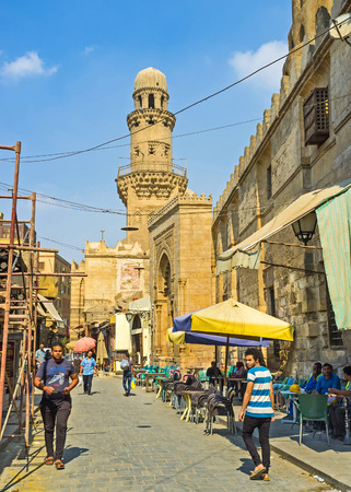 teahouse: CAIRO, EGYPT - OCTOBER 10, 2014:The outdoor teahouse located in shade at the old Mosques wall, on October 10 in Cairo.