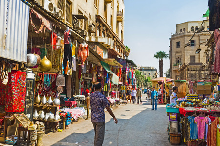 CAIRO, EGYPT - OCTOBER 10, 2014: The picturesque arabic bazaar in Jawhar Al Qaed street with many local souvenirs and traditional crafts, on October 10 in Cairo.