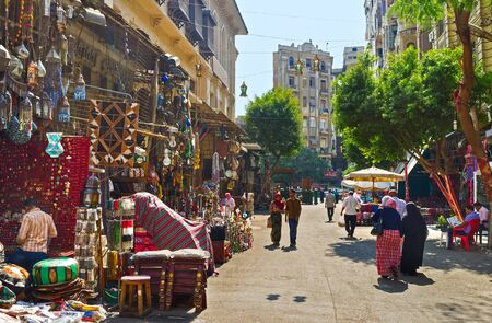 haggling: CAIRO, EGYPT - OCTOBER 10, 2014: The Khan El-Khalili souq is the best place to enjoy the traditional crafts, buy some souvenirs, to bargain with the local sellers, on October 10 in Cairo.