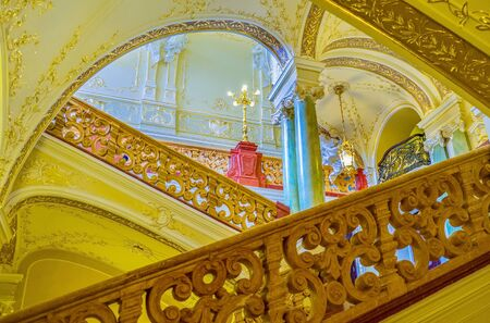 telamon: ODESSA, UKRAINE - MAY 17, 2015: The beautiful stone handrails of the Opera Theatre are the visit cards of the interior, on May 17 in Odessa.
