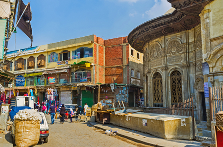 muhammad: CAIRO, EGYPT - OCTOBER 12, 2014: The medieval building of Sabil of Muhammad Ali Pasha (public fountain) among the unfinished stores in Al-Muizz street market, on October 12 in Cairo.