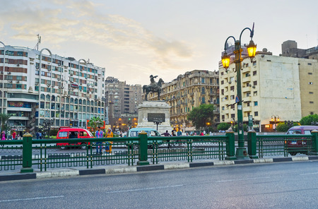 viceroy: CAIRO, EGYPT - OCTOBER 12, 2014: Al Opera square becomes noisy and crowded place in the evening, on October 12 in Cairo.