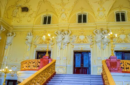 telamon: ODESSA, UKRAINE - MAY 17, 2015: The staircases leads to the richly decorated balcony with entrances to the lodges of the Opera Theater, on May 17 in Odessa.