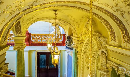 telamon: ODESSA, UKRAINE - MAY 17, 2015: All elements of the interior of the Opera Theater are gold-plated, on May 17 in Odessa.