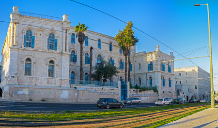 yafo: JERUSALEM - FEBRUARY 15, 2016: The old building of St Louis Hospital of Latin Patriarchate located next to the medieval ramparts of old town, on February 15 in Jerusalem.