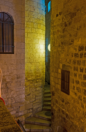 jewish houses: The narrow street with winding stairs between the huge stone walls of the houses in Jewish Quarter, on February 16 in Jerusalem. Stock Photo
