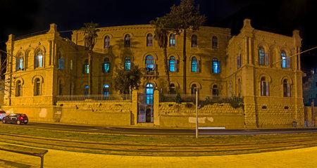 yafo: The facade of St Louis Hospital in the evening illumination, Jerusalem, Israel.