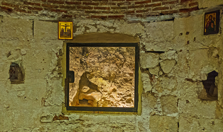 sepulchre: JERUSALEM, ISRAEL - FEBRUARY 16, 2016: The Rock of Calvary (Golgotha), located in Adams Chapel in the Church of the Holy Sepulchre, on February 16 in Jerusalem. Editorial