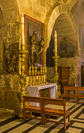 church of the holy sepulchre: JERUSALEM, ISRAEL - FEBRUARY 16, 2016: The Altar of St Mary Magdalene in Church of the Holy Sepulchre decorated with the modern sculpture, on February 16 in Jerusalem.